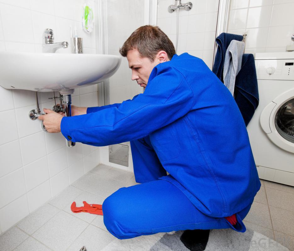 plumber-repairing-drainpipe
